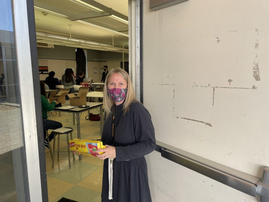 Andre Villani, FHS's Activities Director, standing outside her classroom as her students work on projects.